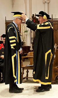 His Eminence, Thomas Cardinal Collins, Archbishop, Diocese of Toronto, and Chancellor of the University of St Michael's College installs David Mulroney as President and Vice-Chancellor of the University of St. Michael's College