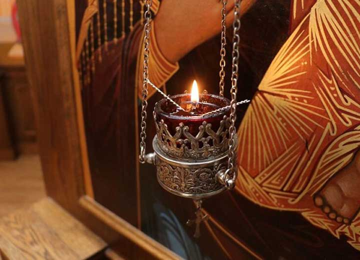 Image depicts MASI candle in front of icon