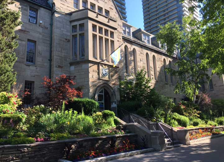 Image depicts the front of Brennan Hall on a sunny day
