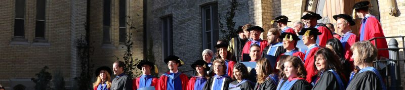 Image depicts students in the faculty of theology dressed in convocation regalia