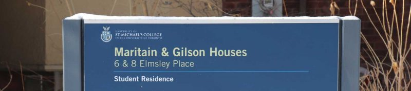 Image depicts the sign for historic houses 6&8 residences on campus