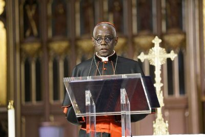 Image depicts Cardinal Sarah speaking in the Cathedral