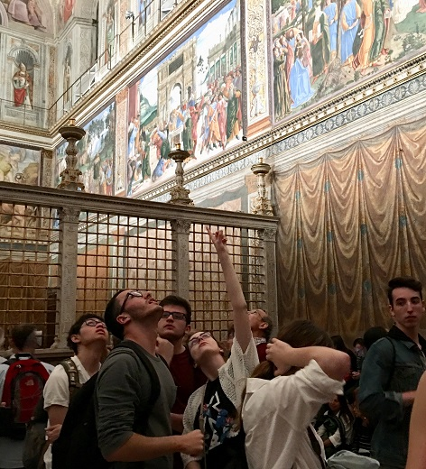 Image depicts students inside the Sistine chapel