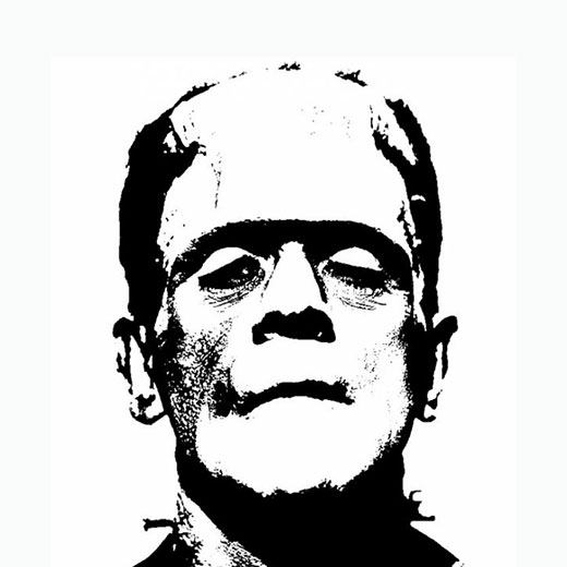 Image depicts a black and white photo of Frankenstein the monster