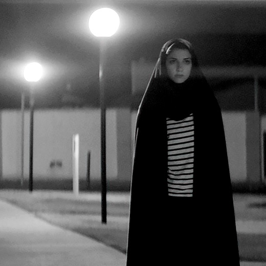 Image depicts the poster for St. Mikes movie night A girl walks home alone at night