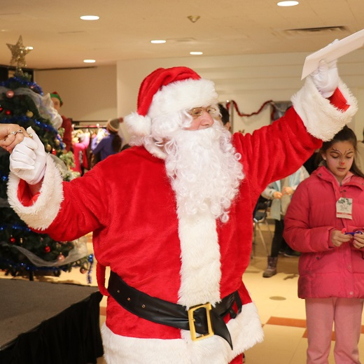 Image depicts santa collecting letters at the Santa Claus parade event