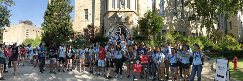 Image depicts students standing on Elmsley place in Orientation groups doing cheers