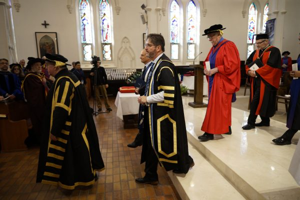 Dr. David Sylvester joins the recessional after formally being made president of the University of St. Michael's College.
