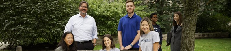 Image depicts students on the quad with Dr. David Sylvester