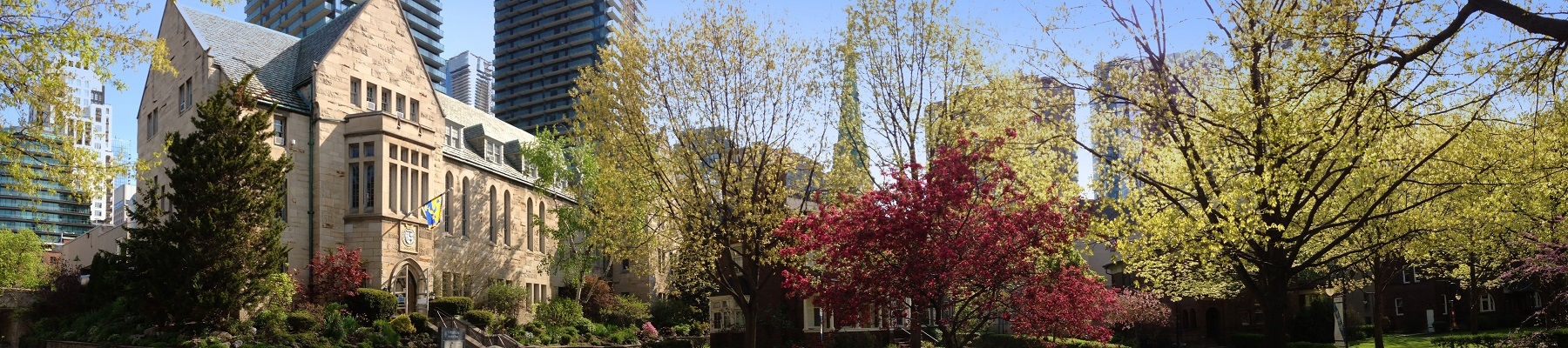 Image depicts Brennan Hall and the Quad in the fall