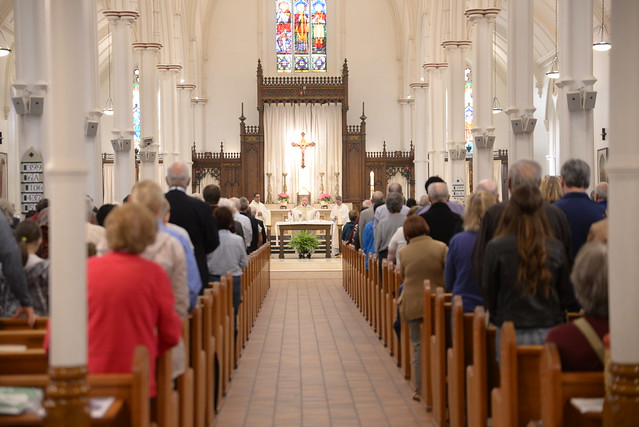 Image depicts a photo of Alumni having mass at the reunion
