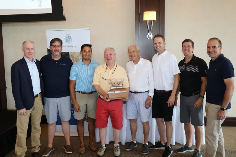 The 2019 St. Mike's Golf Classic winning team from the Archdiocese of Toronto Catholic Pastoral Centre receives their trophy from President David Sylvester and this year's Golf Classic Co-Chairs. Left to right: Jim McGovern (Golf Classic co-chair, USMC class of 1985), David Sylvester, Kevin Fawcett (USMC Class of 2008, U of T MA 2010, U of T PhD), Jim Milway (USMC Class of 1973), John McGrath (USMC Class of 1963), Jerome McGrath (USMC Class of 2005), Barry McInerney (Golf Classic co-chair, USMC class of 1985), and David Scandiffio (Golf Classic co-chair, USMC Class of 1994).