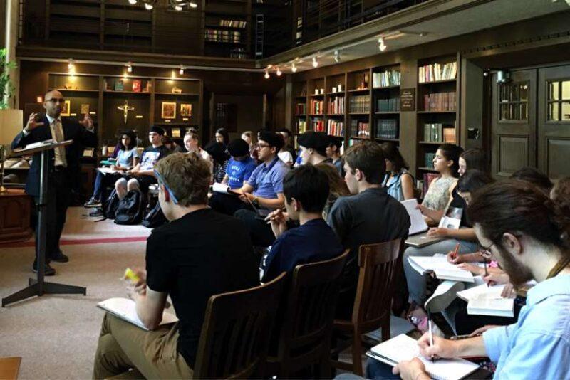 St. Michael's Principal Randy Boyagoda teaches the Gilson Seminar in Faith and Ideas in the Shook Common Room.
