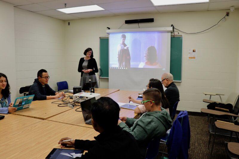 Dr. Callie Callon teaching a graduate class