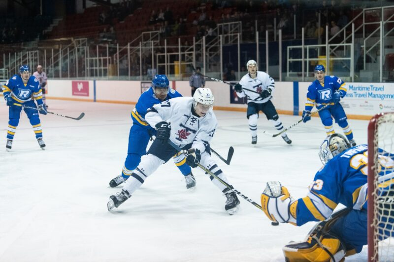 St. Michael's student athlete and Varsity Blues Men's Hockey forward Kyle Potts approaches the goal during a game against the Ryerson Rams.