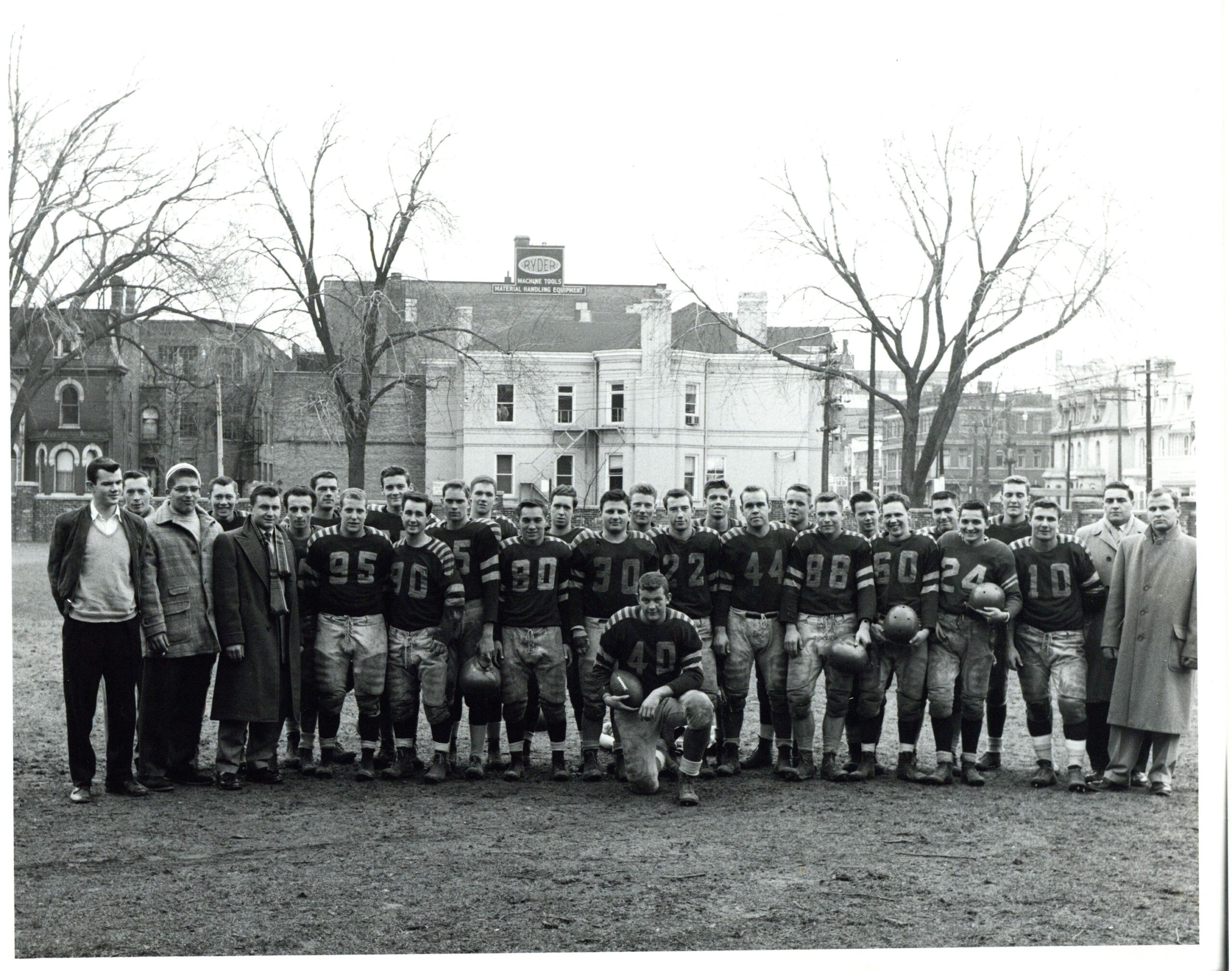 Image depicts a black and white photo of the St.Michael's college football team