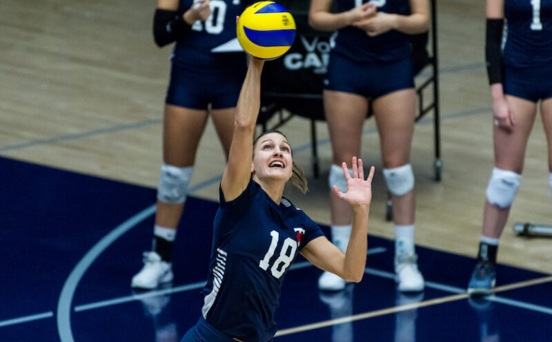 St. Michael's student athlete Anna Licht serves during a Varsity Blues volleyball match.
