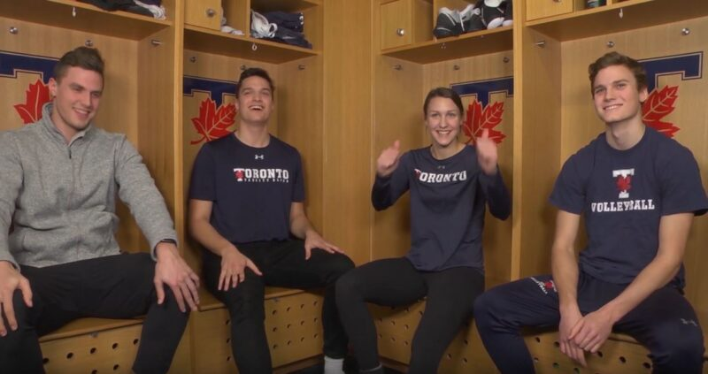 Johann, Martin, Anna, and Benedikt Licht sit together in a locker room during a video.