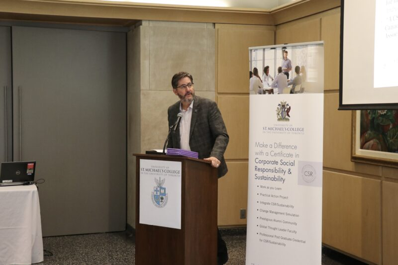 St. Michael's President David Sylvester speaks at a CSR event.