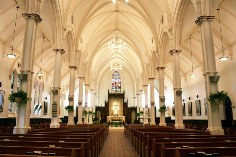 Image depicts the interior of St. Basil's Church facing the altar from the back.