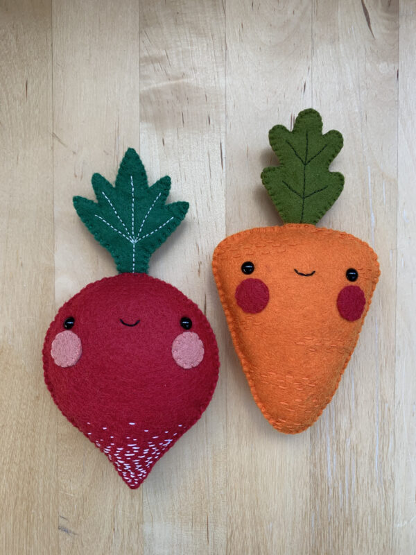Photograph of hand-sewn radish and carrot plushies