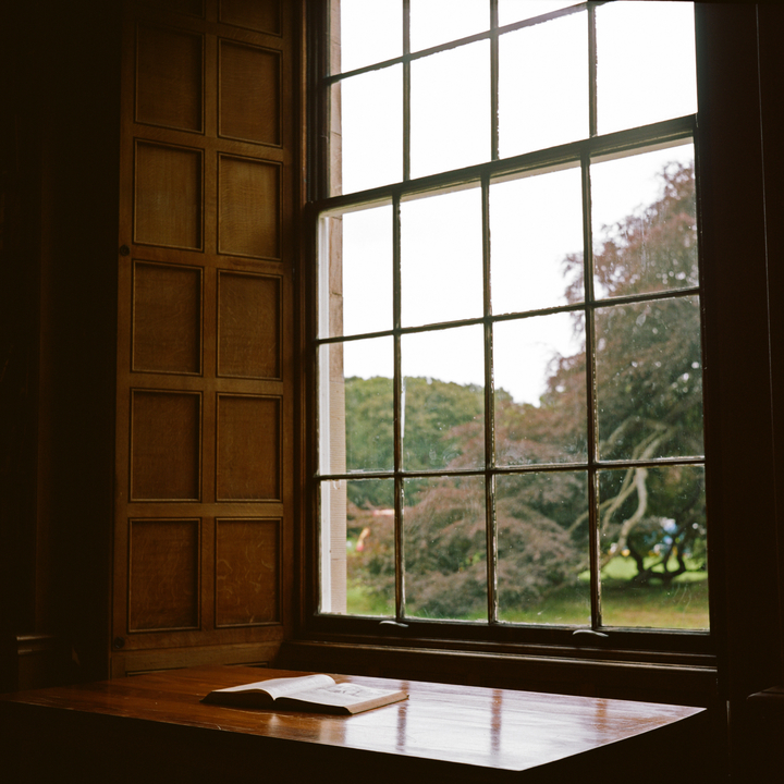 Image of an open window looking out onto an autumn landscape