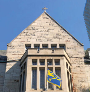 View of Brennan Hall's flag and pediment at St. Michael's College