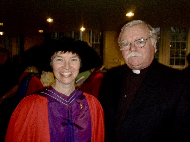 Photograph of Michael Fahey, S.J. standing next the late Dr. Margaret O'Gara in her academic robes.