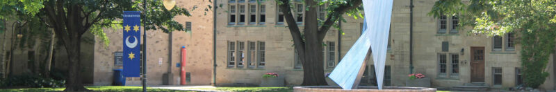 Image depicts the statue of St.Michael's in the USMC Quad on a sunnyday